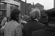 Dr Herrema Kidnap Trial Begins.    K9..1976..23.02.1976..02.23.1976..23rd February 1976..After a period of incarceration, the trial of Eddie Gallagher finally got under way at the Special Criminal Court, Green Street, Dublin. Gallagher was charged with the kidnap of the Dutch Industrialist, Dr Tiede Herrema. The kidnap ended with the release of Dr Herrema after a siege at Monasterevin, Co Kildare...A brother of Eddie Gallagher (Check jacket) is pictured in the crowd waiting for the arrival of the van containing the accused.