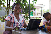 Linna Kinabo doing some record keeping on her laptop. <br /> <br /> Linna set up and now runs a poultry business selling both eggs and meat.<br /> <br /> She attended MKUBWA enterprise training run by the Tanzania Gatsby Trust in partnership with The Cherie Blair Foundation for Women.