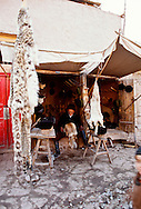 Kashgar or Kasgar China, Xinjiang Province, Uyghur or Uygur Muslim fur shop with Snow Leopard pelt for sale, endangered species