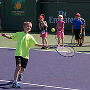 March 7, 2015, Indian Wells, California:<br /> Kids play on court during Kids Day at the Indian Wells Tennis Garden in Indian Wells, California Saturday, March 7, 2015.<br /> (Photo by Billie Weiss/BNP Paribas Open)
