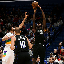 Feb 12, 2019; New Orleans, LA, USA; Orlando Magic forward Jonathan Isaac (1) shoots over New Orleans Pelicans forward Anthony Davis (23) during the second quarter at the Smoothie King Center. Mandatory Credit: Derick E. Hingle-USA TODAY Sports