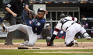 CHICAGO - APRIL 07:  Tim Beckham #1 of the Seattle Mariners slides home safely against the Chicago White Sox on April 7, 2019 at Guaranteed Rate Field in Chicago, Illinois.  (Photo by Ron Vesely)  Subject:  Tim Beckham
