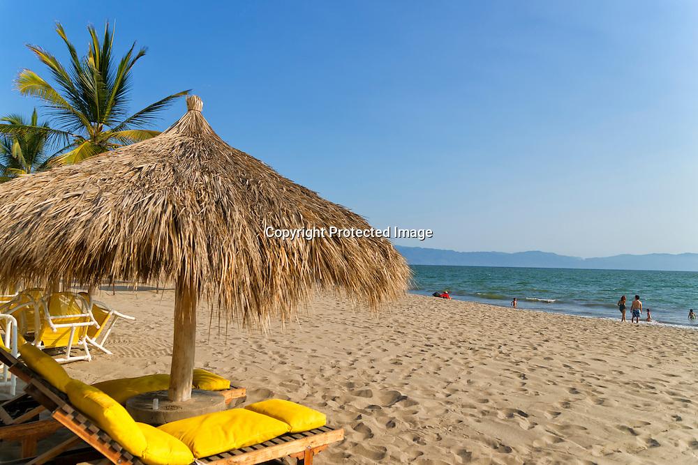 Family enjoying beach vacations on Nuevo Vallarta, Mexico.