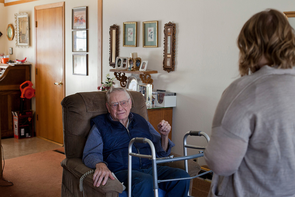 Marvin Hoppenworth speaks with Horizons volunteer coordinator Anna Ronnebaum during her Meals on Wheels delivery in Cedar Rapids, Iowa on Thursday, November 19, 2015. Hoppenworth and his wife are new to the program, but say they've come to depend on the daily lunches since making meals for themselves has become more challenging. (Rebecca F. Miller/Freelance for The Gazette)