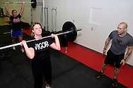 (from left) Danielle McCown, Tracy Belt and owner Jason Hoskins during a workout of the day session at Vigor Crossfit in Moraine, Wednesday, January 25, 2012.