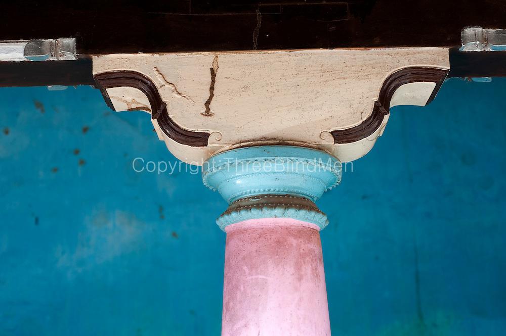 Detail of painted pillar and capital. Nagore. South India. Tamil Nadu.