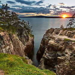 Sunset from the Schoodic Peninsula in Maine's Acadia National Park. Raven's Nest.