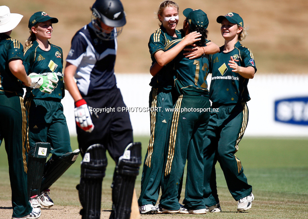 Australia celebrate a wicket during the 4th ODI Rose Bowl Series cricket match between New Zealand White Ferns and Australia at Seddon Park, Hamilton, New Zealand, Sunday 08 February 2009. Photo: Simon Watts/PHOTOSPORT