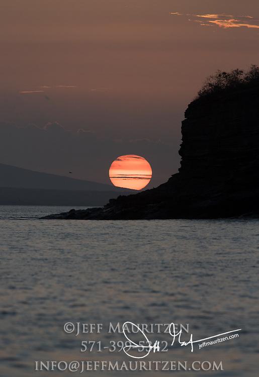 Sunset over Fernandina island, Galapagos islands, Ecuador.
