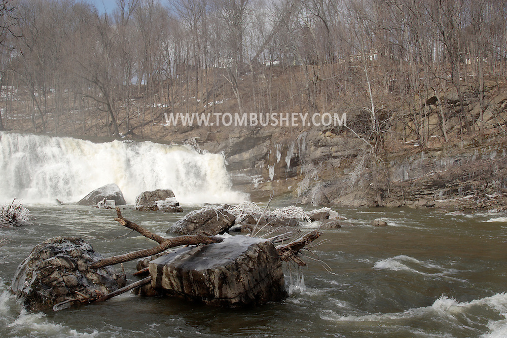 High Falls, NY - The Rondout Creeks flows over the waterfall on a cold, winter afternoon. Feb. 19. 2008.