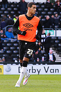 Derby County midfielder Tom Ince (23) warms up ahead of the Sky Bet Championship match between Derby County and Sheffield Wednesday at the iPro Stadium, Derby, England on 21 February 2015. Photo by Aaron Lupton.