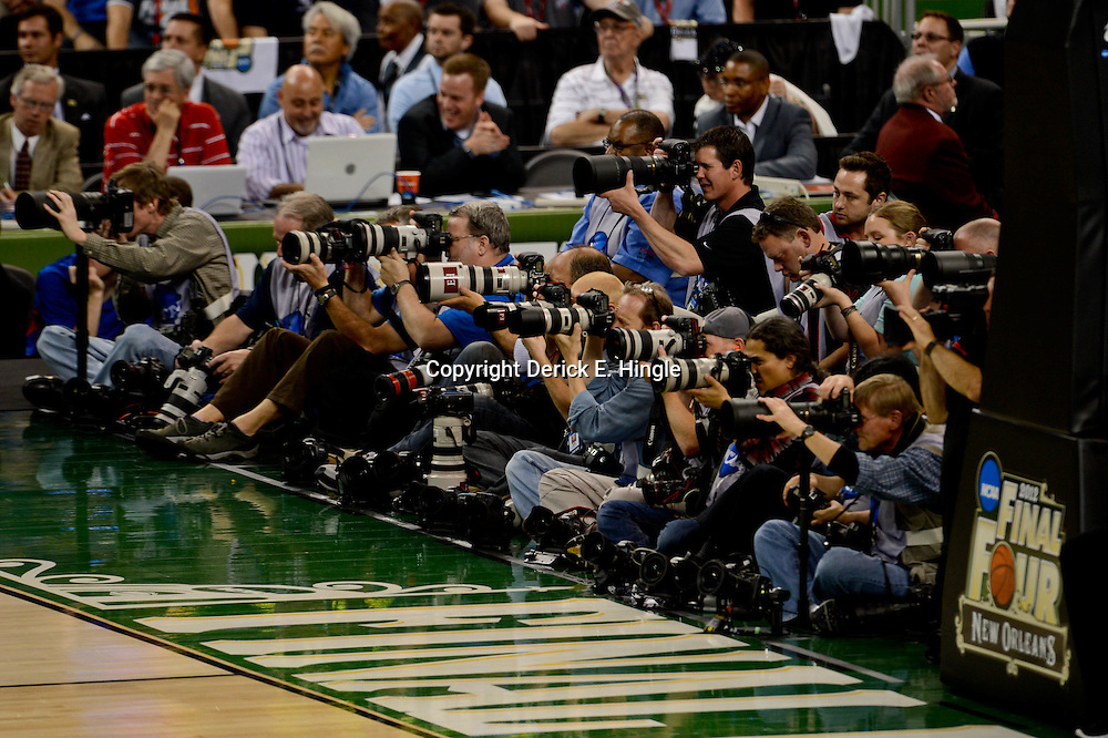Apr 2, 2012; New Orleans, LA, USA; Photographers on the baseline during the first half in the finals of the 2012 NCAA men's basketball Final Four between the Kansas Jayhawks and the Kentucky Wildcats at the Mercedes-Benz Superdome. Mandatory Credit: Derick E. Hingle-US PRESSWIRE