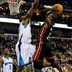 November 5, 2010; New Orleans, LA, USA; Miami Heat shooting guard Dwyane Wade (3) shoots over New Orleans Hornets center Emeka Okafor (50) during a game at the New Orleans Arena. The Hornets defeated the Heat 96-93. Mandatory Credit: Derick E. Hingle