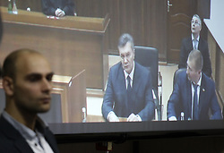 November 25, 2016 - Kiev, Ukraine - Former Ukrainian president Viktor Yanukovych is seen on a screen by via live video link from Russia,as he attends a hearing during a trial session in a district court in Kiev, Ukraine, 25 November 2016. Svyatoshinsky District Court of Kyiv held a hearing in the case of the Maidan events, questioning witness Ukrainian former Viktor Yanukovych (C) in the case of five former Berkut riot police officers, who are accused of murdering Maidan activists in February 2014. (Credit Image: © Serg Glovny via ZUMA Wire)