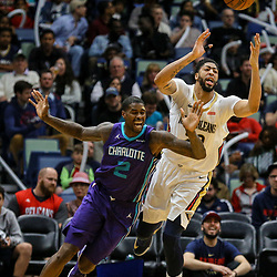 Mar 13, 2018; New Orleans, LA, USA; New Orleans Pelicans forward Anthony Davis (23) and Charlotte Hornets forward Marvin Williams (2) scramble for a loose ball during the third quarter of a game at the Smoothie King Center. The Pelicans defeated the Hornets 119-115.  Mandatory Credit: Derick E. Hingle-USA TODAY Sports
