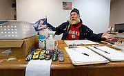 Homeless veteran Kenneth Bailey, who's street name is Wulf, talks with Terra Salinas (not pictured), of Gathering Friends, on Tuesday, Dec. 5, 2016 while sitting at the desk in the library he helps maintain at the Veterans Coming Home Center in Springfield.