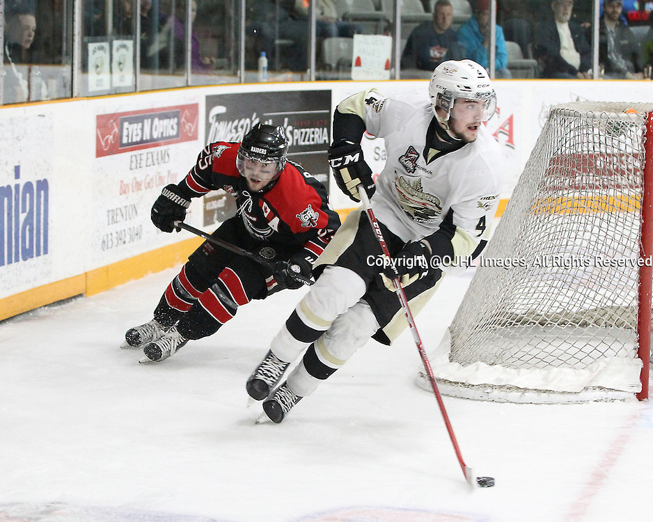 TRENTON, ON - Apr 18, 2016 -  Ontario Junior Hockey League game action between Trenton Golden Hawks and the Georgetown Raiders. Game 3 of the Buckland Cup Championship Series  at the Duncan Memorial Gardens in Trenton, Ontario. Chays Ruddy #4 of the Trenton Golden Hawks skates with the puck pursued by Brendan Jacome #25 of the Georgetown Raiders during the third period.<br /> (Photo by Tim Bates / OJHL Images)
