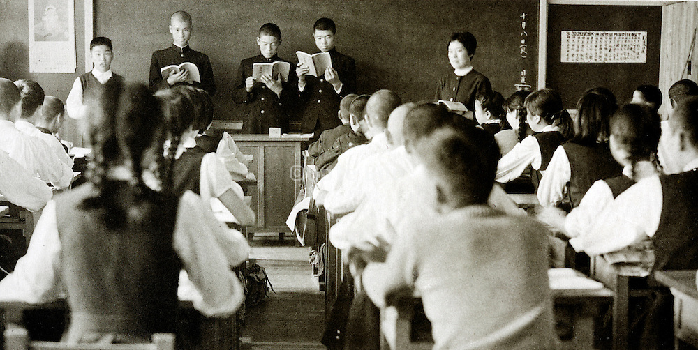 junior high classroom with students reading in front of blackboard Japan 1958