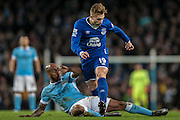 Gerard Deulofeu (Everton) is tackled during the Capital One Cup semi-final match between Manchester City and Everton at the Etihad Stadium, Manchester, England on 27 January 2016. Photo by Mark P Doherty.