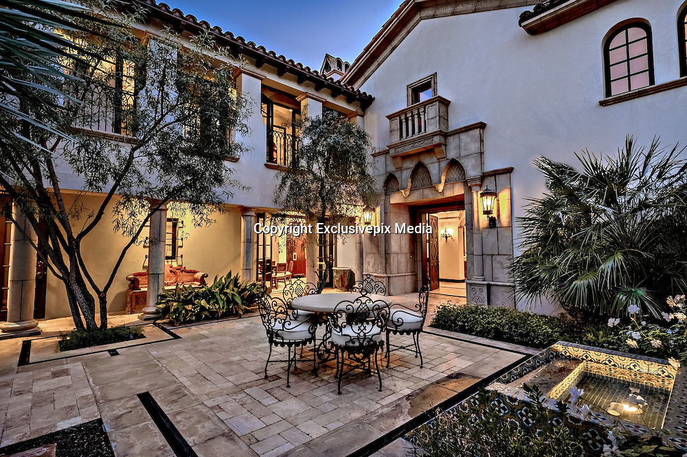 Sylvester Stallone's southern California mansion - It's a knockout<br /> <br /> Action movie star Sylvester Stallone's luxurious desert retreat was not just a place to escape Los Angeles but also where the artist could enjoy his paintings. The home, now up for sale at US$4.2 million, features plenty of Rambo and Rocky's own works of art.<br /> <br /> The Mediterranean Revival-style villa, located in an exclusive gated golf club community in La Quinta, near Palm Springs, features four bedrooms and 4.5 bathrooms over its 480 sq.m.<br /> <br /> Interior details include arched entryways, stone-carved fireplaces and high wooden ceilings. The two-story residence also features two master bedrooms with fireplaces, bars and walk-in closets.<br /> <br /> Outside, set over 1820 sq.m, there are a number of terraces, including a tiled fire pit, pool and spa, overlooking the surrounding mountains and the creek that runs through the property.<br /> &copy;Exclusivepix Media