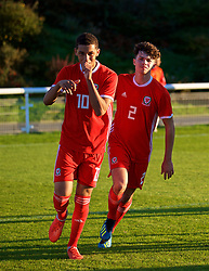 BANGOR, WALES - Monday, October 15, 2018: Wales' Brennan Johnson (L) celebrates scoring the first goal with team-mate Neco Williams during the UEFA Under-19 International Friendly match between Wales and Poland at the VSM Bangor Stadium. (Pic by Paul Greenwood/Propaganda)