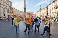 Roma 6 Agosto 2014<br /> Sono tornati per pochi minuti i dehors a Piazza Navona. I titolari dei ristoranti  hanno deciso di alzare le saracinesche e ripristinare gli spazi esterni, ma posizionando i tavolini nel rispetto dei limiti imposti dalle concessioni del comune di Roma. Ma gli agenti della municipale li hanno bloccati: &quot;Non sono autorizzati&quot;.<br /> Rome August 6, 2014 <br /> They came back for a few minutes the dehors in the Piazza Navona. The owners of the restaurants have decided to raise the  rolling shutter and restore the dehors, but by placing the tables within the limits imposed by the concessions of the city of Rome. But the agents of the municipal blocking them: &quot;They are not unauthorised &quot;