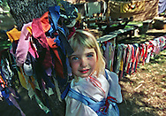 "Rachael Covington, 3, framed by a rag rope around an oak tree pauses during the Fair Oaks ""Renaissance Tudor Fayre.""   The 13th annual fair sponsored by the Fair Oaks Park and Recreation district,  attracted about 800 particiapants in Renaissance costumes singing, dancing and eating their way through the two-day event."