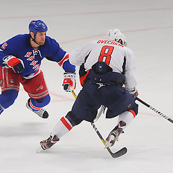 April 30, 2012: New York Rangers defenseman Dan Girardi (5) lines up Washington Capitals left wing Alex Ovechkin (8) for an open ice hit during third period action in Game 2 of the NHL Eastern Conference Semifinals between the Washington Capitals and New York Rangers at Madison Square Garden in New York, N.Y.