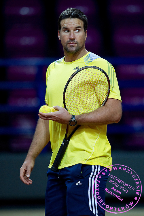 Patrick Rafter - captain of Australia team while training sessin four days during the BNP Paribas Davis Cup 2013 between Poland and Australia at Torwar Hall in Warsaw on September 09, 2013.<br /> <br /> Poland, Warsaw, September 09, 2013<br /> <br /> Picture also available in RAW (NEF) or TIFF format on special request.<br /> <br /> For editorial use only. Any commercial or promotional use requires permission.<br /> <br /> Photo by © Adam Nurkiewicz / Mediasport