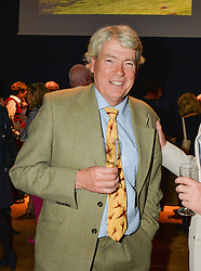 Left, PHIL BURTT at a party to celebrate the publication of Capability Brown & Belvoir - Discovering a lost Landscape by The Duchess of Rutland, held at Christie's, 8 King Street, St.James, London on 7th October 2015.