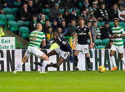4th April 2018, Celtic Park, Glasgow, Scotland; Scottish Premier League football, Celtic versus Dundee; Scott Brown of Celtic tacles Glen Kamara of Dundee