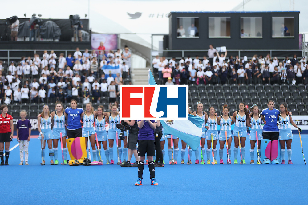 LONDON, ENGLAND - JUNE 21: A flag bearer holds the Argentina flag in front of the Argentina team as the anthems play prior to the FIH Women's Hockey Champions Trophy match between Australia and Argentina at Queen Elizabeth Olympic Park on June 21, 2016 in London, England.  (Photo by Alex Morton/Getty Images)