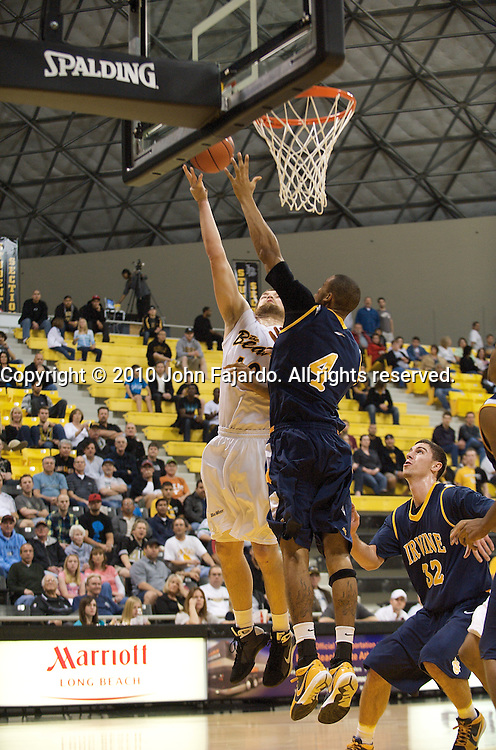 Arturas Lazdauskas(L) is blocked by Zack Atkinson(4) in the Big West Conference game against U.C. Irvine at the Walter Pyramid, Long Beach Calif, Saturday, Jan. 9, 2010.