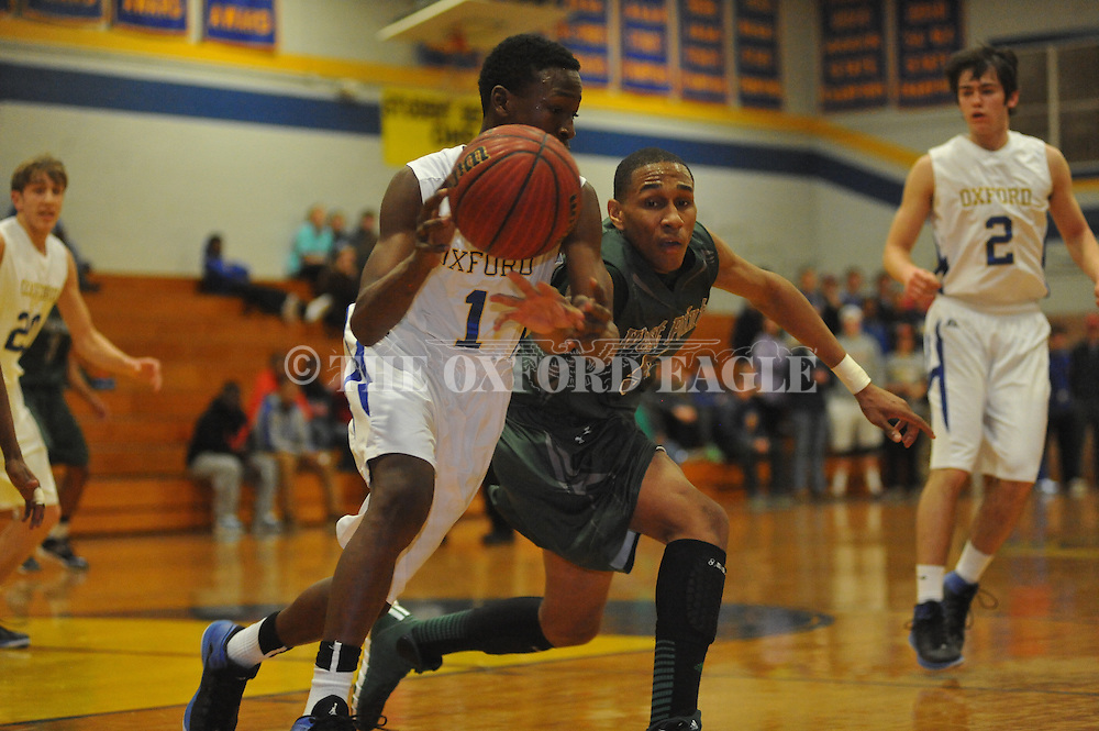 Oxford High's Jarkel joiner (1) vs. West Point's Trey Williams (5) in boys high school basketball in Oxford, Miss. on Tuesday, January 21, 2014.