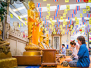 "12 OCTOBER 2012 - RAI KHRING, NAKHON PATHOM, THAILAND:  Thai Buddhists pray at Buddha statues in Wat Rai Khring in Nakhon Pathom province. Wat Rai Khring was built in 1791. The Abbot at the time, Somdej Phra Phuttha Chan (Pook), named the temple after the district. When construction was completed, the Buddha image was brought from another temple and enshrined here. Later locals named the image ""Luang Pho Wat Rai Khing"". The Buddha image is of Chiang Saen style and is assumed to have been built by Lanna Thai and Lan Chang craftsmen.     PHOTO BY JACK KURTZ"