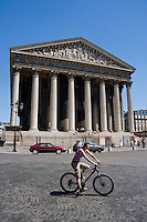 cyclist around Église de la Madeleine Paris France in May 2008