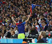 French fan trying to inspire a very quiet crowd during the Rugby World Cup Pool D match between France and Romania at the Queen Elizabeth II Olympic Park, London, United Kingdom on 23 September 2015. Photo by Matthew Redman.