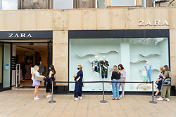Edinburgh, Scotland, UK. 24 July, 2020. Social distancing in queue outside Zara on Princes Street in Edinburgh. Iain Masterton/Alamy Live News