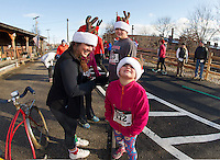 "Jeannine Page with Erica, Ayden and Addi Duncan moments before the start of the ""Santa Shuffle"" with the Downtown Gym on Sunday morning.  (Karen Bobotas/for the Laconia Daily Sun)"