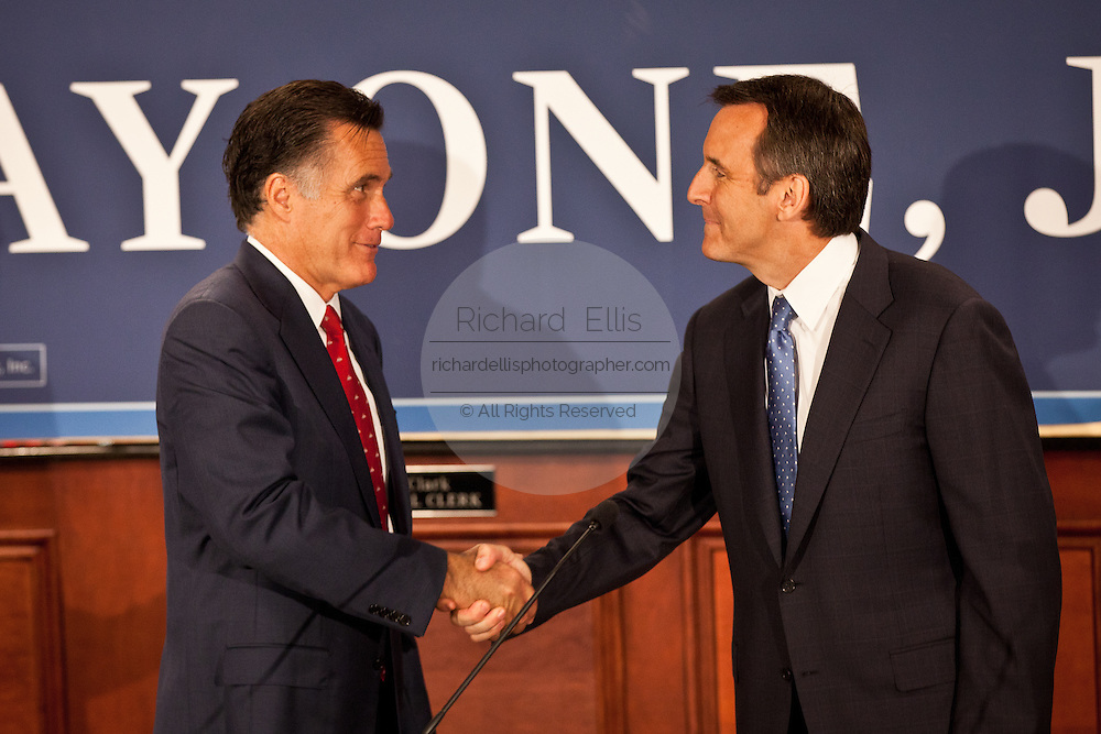 Gov. Mitt Romney shakes hands with Gov. Tim Pawlenty on September 12, 2011 in North Charleston, South Carolina.  Pawlenty who quit the Republican nomination last month endorsed Romney for President.