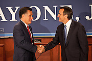 Gov. Mitt Romney shakes hands with Gov. Tim Pawlenty on September 12, 2011 in North Charleston, South Carolina.  Pawlenty who quit the Republican nomination last month endorsed Romney for President.