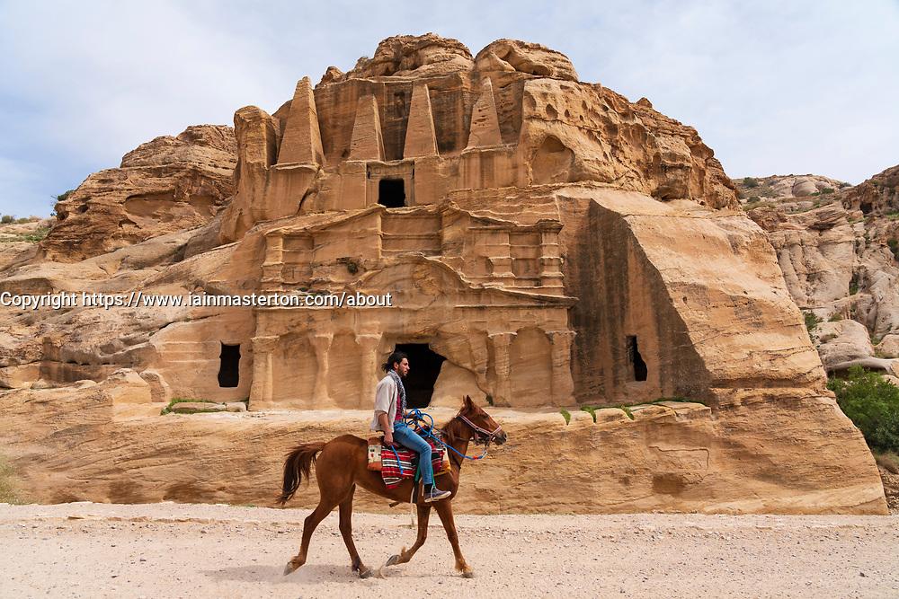 A horse walks past the Obelisk Tomb in Petra, Jordan. Work heritage site