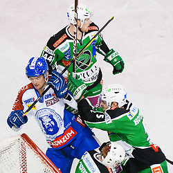 Scott Hotham (HDD Tilia Olimpija, #5) and Jamie Fraser (HDD Tilia Olimpija, #44) vs Vyacheslav Trukhno (KHL Medvescak Zagreb, #11) during ice-hockey match between HDD Tilia Olimpija and KHL Medvescak Zagreb in 30th Round of EBEL league, on December 9, 2011 at Hala Tivoli, Ljubljana, Slovenia. KHL Medvescak Zagreb defeated HDD Tilia Olimpija 5:3. (Photo By Matic Klansek Velej / Sportida)