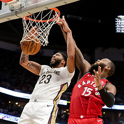 Oct 11, 2018; New Orleans, LA, USA; New Orleans Pelicans forward Anthony Davis (23) dunks over Toronto Raptors center Greg Monroe (15) during the first half at the Smoothie King Center. Mandatory Credit: Derick E. Hingle-USA TODAY Sports