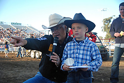 "Jack Nolan, right, winner of the ""Mutton Bustin"" trophy, gets some help finding the TV cameras at the 102nd California Rodeo Salinas, which opened July 19 for a four-day run."