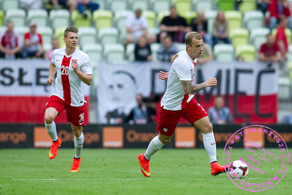 (R) Poland's Kamil Grosicki and (L) Poland's Lukasz Piszczek in action during international friendly match between Poland and Lithuania at PGE Arena in Gdansk, Poland.<br /> <br /> Poland, Gdansk, June 06, 2014<br /> <br /> Picture also available in RAW (NEF) or TIFF format on special request.<br /> <br /> For editorial use only. Any commercial or promotional use requires permission.<br /> <br /> Mandatory credit:<br /> Photo by &copy; Adam Nurkiewicz / Mediasport
