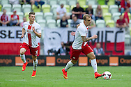 (R) Poland's Kamil Grosicki and (L) Poland's Lukasz Piszczek in action during international friendly match between Poland and Lithuania at PGE Arena in Gdansk, Poland.<br /> <br /> Poland, Gdansk, June 06, 2014<br /> <br /> Picture also available in RAW (NEF) or TIFF format on special request.<br /> <br /> For editorial use only. Any commercial or promotional use requires permission.<br /> <br /> Mandatory credit:<br /> Photo by © Adam Nurkiewicz / Mediasport