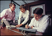 Bill Gates (C) with Jeff Raikes (L) and Lloyd Frink (R) meet to discuss development of Mircrosoft Pen Computing project, Photographed at Microsoft campus Redmond WA.
