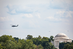 August 27, 2017 - Washington, DC, United States - A helicopter flys above The Thomas Jefferson Memorial, from the South Lawn of the White House, on Sunday, August 27, 2017. (Photo by Cheriss May) (Credit Image: © Cheriss May/NurPhoto via ZUMA Press)