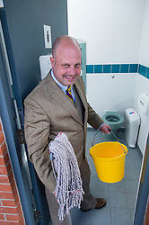 © London News Pictures. FILE PIC DATED 18/04/2013. UKIP Local Government spokesman, Peter Reeve, husband of UKIP Councillor LISA DUFFY pictured cleaning the toilets in the town centre of Ramsey in Cambridgeshire. Lisa Duffy is to run for leadership of UKIP.. Photo credit: Ben Cawthra/LNP